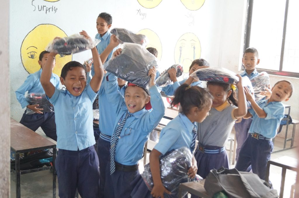 Happy pupils with their new school uniform